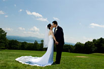 A bride and groom infront of the view at Steele Hill