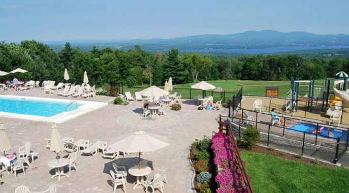 A view of the outdoor pool deck at Steele Hill overlooking the lakes and mountains