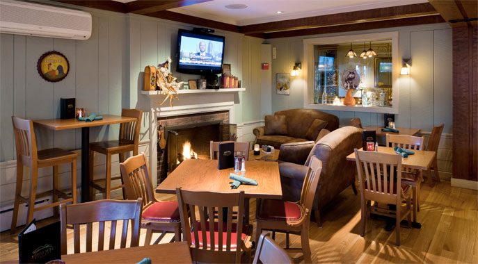 The cozy fireplace and comfortable seating in Tova's Tavern