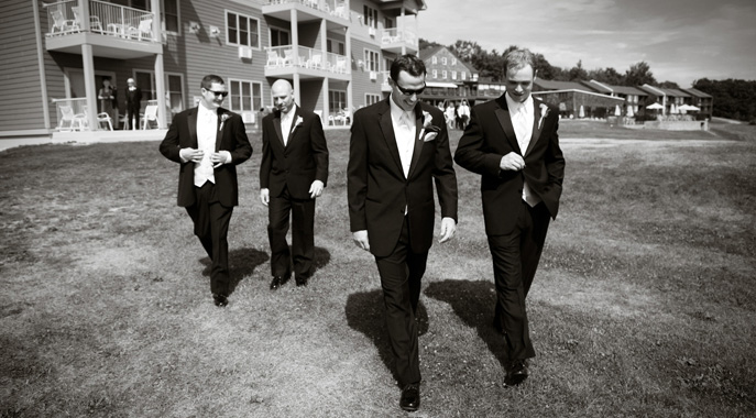 A groom and his best men walk towards their outdoor ceremony at Steele Hill