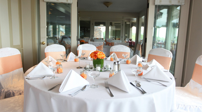 A table setting for a wedding dinner at the Hilltop Restaurant